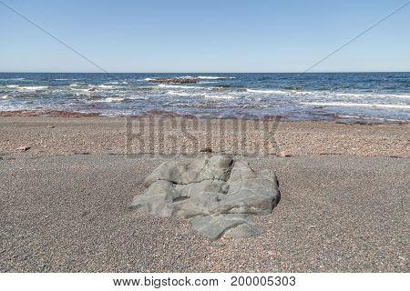 Large Rock In Gravel At Seaside