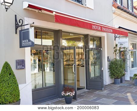 PARIS FRANCE - MAY 10 2017 : Hour Passion boutique in La Vallee Village. Hour Passion is a concept store belonging to the Swatch Group the world's largest watchmaker.