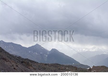 Rocky peaks and rocky landslide view from the of Elbrus North Caucasus Russia.