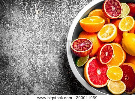 Sliced Citrus Fruits In A Large Bowl .