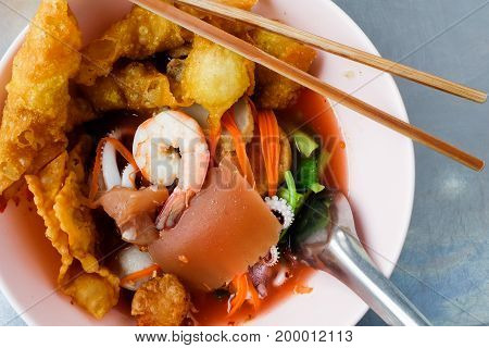 Pink seafood flat noodles morning glory squid and vegetable asia thai food