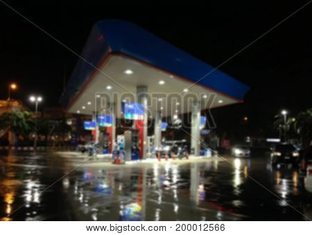 Blur image of gas station at night.Abstract blur petrol station background out of focus