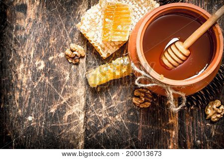 The Honey In The Pot With The Nuts And Cones.