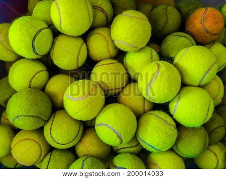 used tennis balls put in the basket