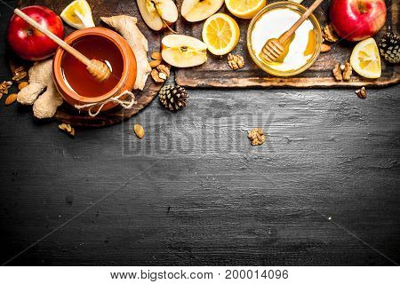 Honey Background. Honey In Pot With Apples, Lemon , Ginger And Nuts.