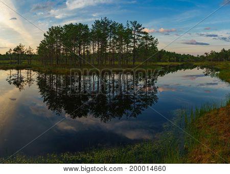 Wonderful sunset cky over Suru Suursoo bog Harju county Estonia. Reflection on calm water