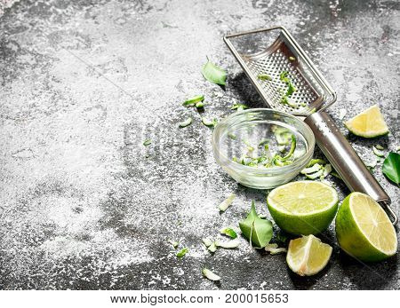 Fresh Limes With Grater And Zest In A Bowl.