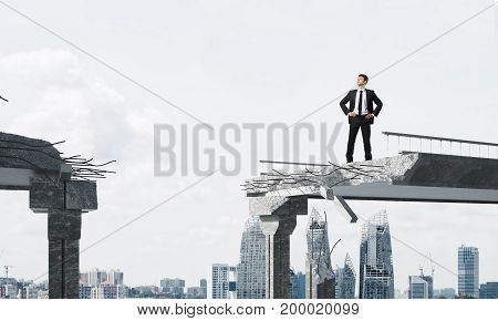 Confident businessman in suit looking away while standing on broken bridge with cityscape on background. 3D rendering.