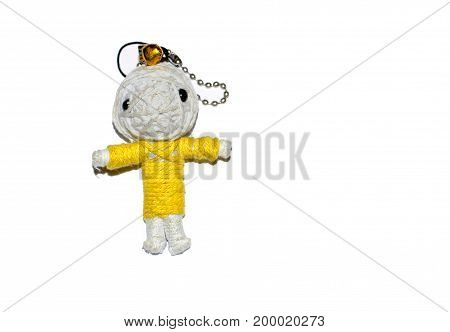 Cute little doll isolated on white background. Charm keychain for a children bag. Kids sewing crafts idea