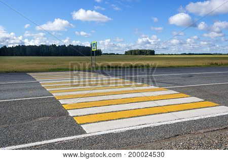 Pedestrian crossing with sign on a country road