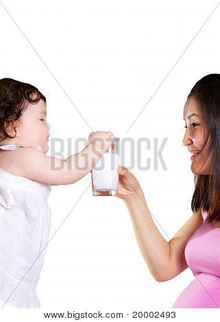 Baby Grabbing Milk