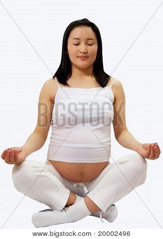 Young Pregnant Asian Woman Meditating