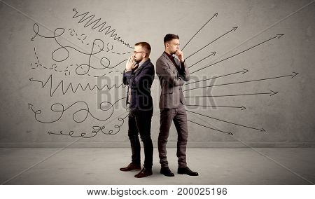 Young conflicted businessman choosing between two directions with arrows and scribbles around him