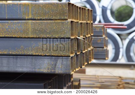 Metal profile pipe of rectangular cross section in packs at the warehouse of metal products Russia