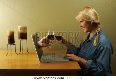 Hand & Wine Glass Coming Through Laptop Screen