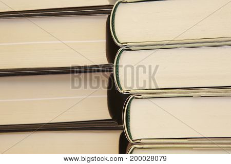 Stacked books. Educational and learning background. School items. Horizontal