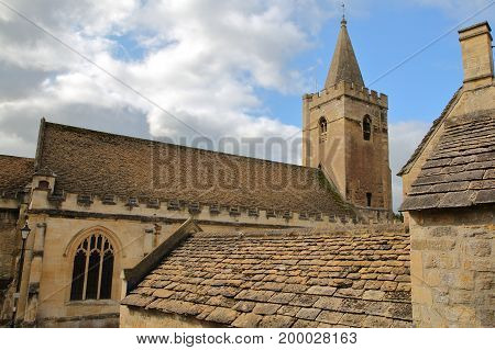 Holy Trinity Church with traditional stone roofs in the foreground, Bradford on Avon, UK