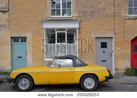 Bradford on Avon, UK - AUGUST 12, 2017: Exterior facade of a house with a vintage car in Tory neighborhood