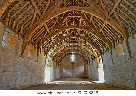 Bradford on Avon, UK - AUGUST 12, 2017: The timber cruck roof of Tithe Barn, a medieval monastic stone barn