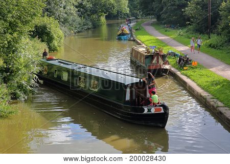 Bradford on Avon, UK - AUGUST 12, 2017: Barges along the Kennet and Avon Canal near Bradford on Avon