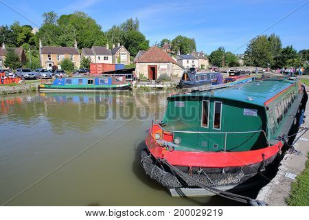 Bradford on Avon, UK - AUGUST 13, 2017: Canal Wharf with colorful barges on Kennet and Avon Canal