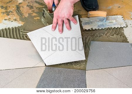 Handyman Laying Ceramic Floor Tiles