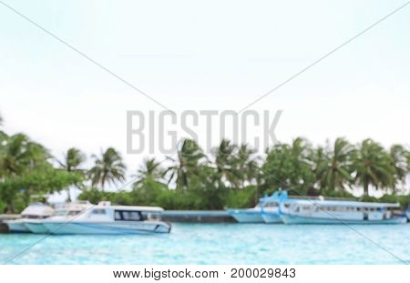 Berth with modern boats at resort, blurred view