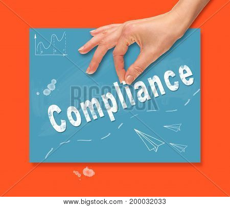 A Hand Picking Up A Compliance Concept On A Colorful Drawing Board.