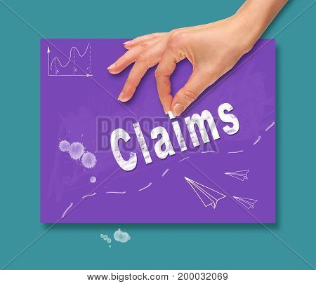 A Hand Picking Up A Claims Concept On A Colorful Drawing Board.