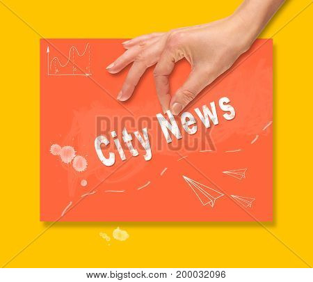 A Hand Picking Up A City News Concept On A Colorful Drawing Board.