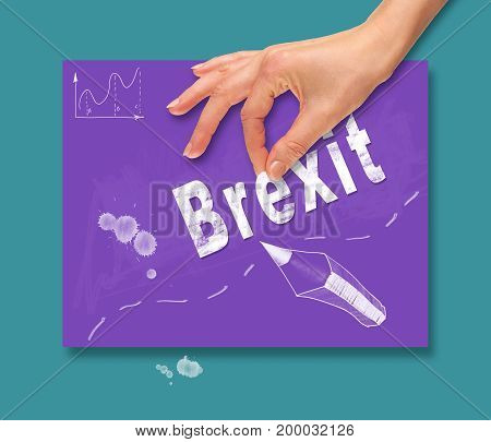A Hand Picking Up A Brexit Concept On A Colorful Drawing Board.