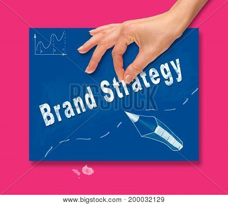 A Hand Picking Up A Brand Strategy Concept On A Colorful Drawing Board.