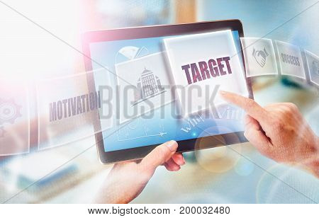 A Businesswoman Selecting A Target Business Concept On A Futuristic Portable Computer Screen.