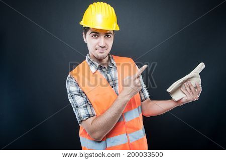 Handsome Constructor Pointing With Glove And Finger