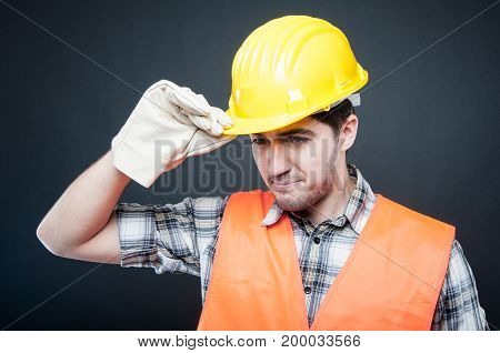 Handsome Constructor Holding Hardhat Wearing Gloves