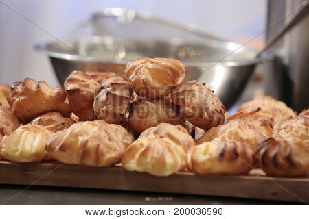 Cakes, eclairs, favorite dessert, recipes of sweets, Classic French cakes eclairs from custard pastry with custard. Desserts - custard eclairs