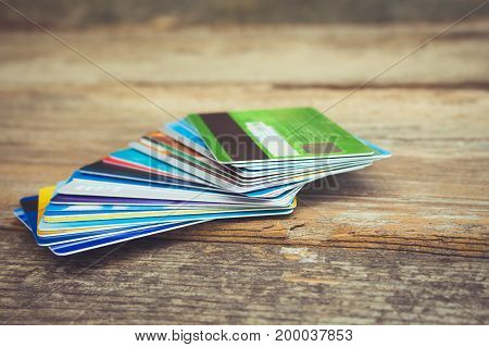 Credit card on wooden background. Toned image.