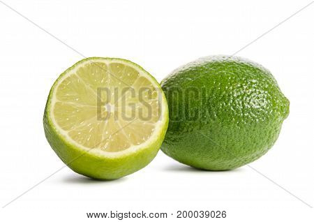 Two Juicy limes over the white background