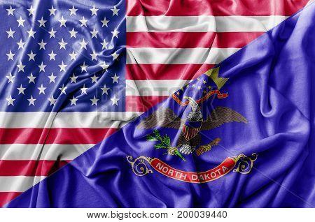 Ruffled waving United States of America and North Dakota flag