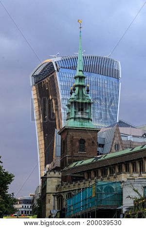 LONDON, GREAT BRITAIN - SEPTEMBER 21, 2014: It's the church All Hallows by the Tower and The Walkie-Talkie skyscraper on an autumn evening.