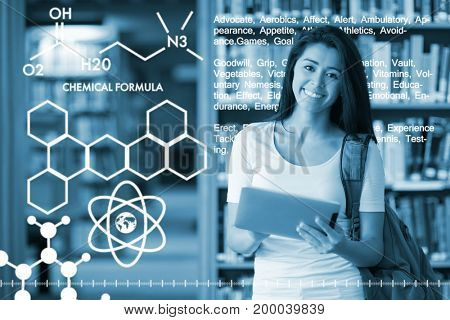 Graphic image of chemical formulas against smiling student using a tablet computer