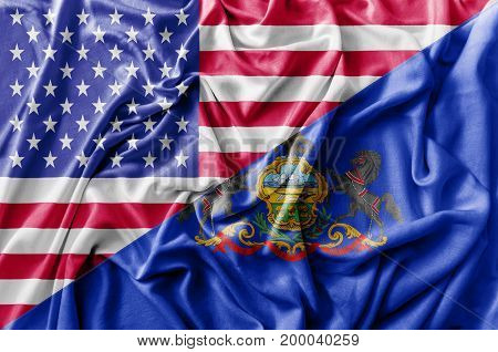 Ruffled waving United States of America and Pennsylvania flag