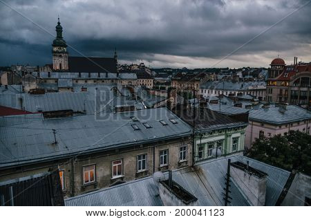 Roofs of Lviv against the cloudscape. Old town in the dusk. Ukraine.