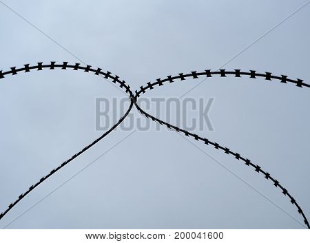 Independence of the barbed wire with sky background.