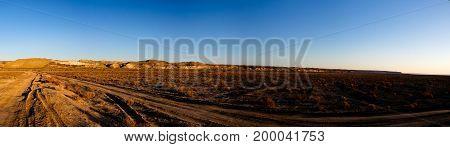 Panorama view to Plateau Ustyurt from the edge of Aral sea near Aktumsuk cape at sunrise in Karakalpakstan Uzbekistan