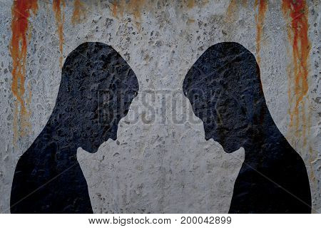 Two shadows of man's body on bloody wall background.