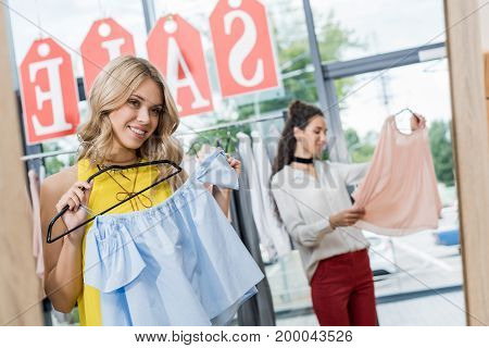 Happy Young Beautiful Women In Clothes Store