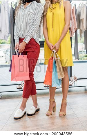 Cropped Shot Of Women With Colorful Bags In Clothes Store