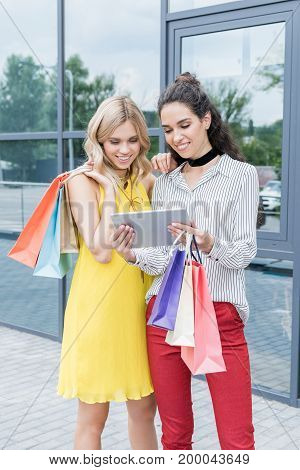 Beautiful Young Women On Shopping Looking At Tablet