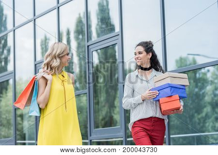 beautiful women on shopping with bags and boxes
